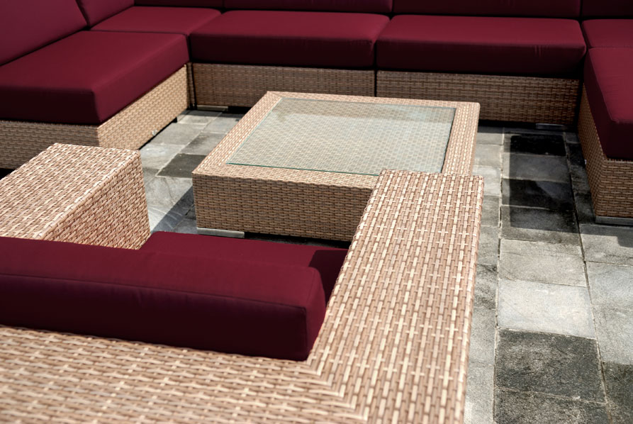 Synthetic wicker chair and coffee table with glass